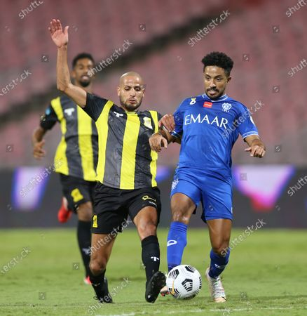 Stock Picture of Al-Ittihad's player Karim El Ahmadi (L) in action against Al-Hilal's Hattan Bahebri (R) during the Saudi Professional League soccer match between Al-Ittihad and Al-Hilal at King Abdulaziz Stadium, in Mecca, Saudi Arabia, 09 April 2021.