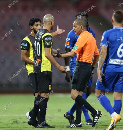 Al-Ittihad's player Karim El Ahmadi (2-L) argue with Moroccan referee Redouane Jayed (2-R) during the Saudi Professional League soccer match between Al-Ittihad and Al-Hilal at King Abdulaziz Stadium, in Mecca, Saudi Arabia, 09 April 2021.