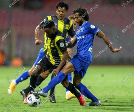 Stock Picture of Al-Ittihad's player Fahad Al Muwallad (L) in action against Al-Hilal's Yasir Al-Shahrani (R) during the Saudi Professional League soccer match between Al-Ittihad and Al-Hilal at King Abdulaziz Stadium, in Mecca, Saudi Arabia, 09 April 2021.