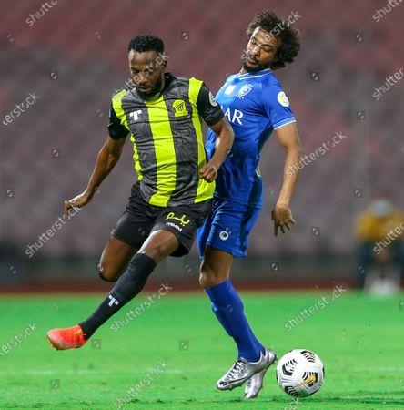 Stock Photo of Al-Ittihad's player Fahad Al Muwallad (L) in action against Al-Hilal's Yasir Al-Shahrani (R) during the Saudi Professional League soccer match between Al-Ittihad and Al-Hilal at King Abdulaziz Stadium, in Mecca, Saudi Arabia, 09 April 2021.