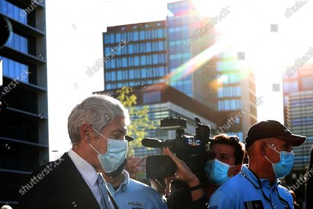 Portugal's former Prime Minister Jose Socrates  wearing a face mask leaves the court after the instructional decision session of the high-profile corruption case known as Operation Marques, at the Justice Campus in Lisbon, Portugal, 09 April 2021.