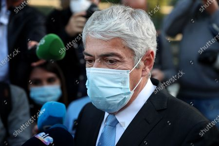 Portugal's former Prime Minister Jose Socrates wearing a face mask speaks to journalists as he leaves the court after the instructional decision session of the high-profile corruption case known as Operation Marques, at the Justice Campus in Lisbon, Portugal, 09 April 2021.