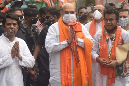 Union Home Minister and Bharatiya Janata Party (BJP) leader Amit Shah and candidate Rudranil Ghosh (R) greeting people during a door-to-door campaign for the Assembly Elections in the state, at Bhowanipore on April 9, 2021 in Kolkata, India.