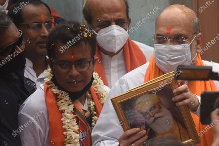 Union Home Minister and Bharatiya Janata Party (BJP) leader Amit Shah and candidate Rudranil Ghosh (L) during a door-to-door campaign for the Assembly Elections in the state, at Bhowanipore on April 9, 2021 in Kolkata, India.