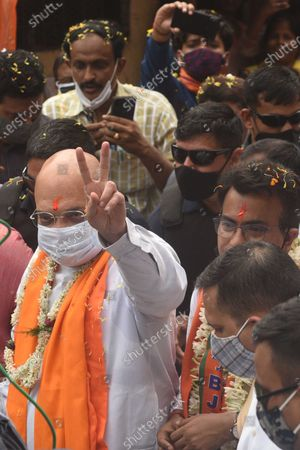 Union Home Minister and Bharatiya Janata Party (BJP) leader Amit Shah greeting people during a door-to-door campaign for the Assembly Elections in the state, at Bhowanipore on April 9, 2021 in Kolkata, India.