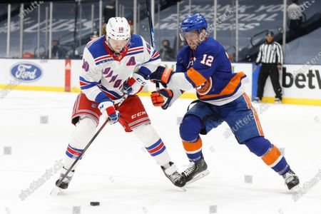 New York Rangers' Artemi Panarin (10), of Russia, shoots against New York Islanders' Josh Bailey (12) during the first period of an NHL hockey game, in Uniondale, N.Y