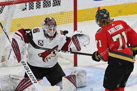 Vegas Golden Knights center William Karlsson (71) watches a shot by Reilly Smith head past Arizona Coyotes goalie Ivan Prosvetov (50) for a goal during the third period of an NHL hockey game, in Las Vegas