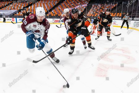 Colorado Avalanche left wing Brandon Saad, left, controls the puck as Anaheim Ducks center Ryan Getzlaf chases in the first period of an NHL hockey game in Anaheim, Calif