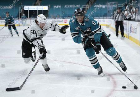 San Jose Sharks left wing Evander Kane (9) skates past Los Angeles Kings defenseman Kale Clague (58) during the third period of an NHL hockey game, in San Jose, Calif. The Sharks won 5-2