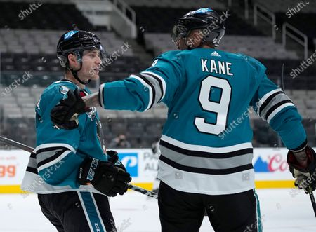 San Jose Sharks center Dylan Gambrell (7) celebrates with Evander Kane (9) after scoring a goal against the Los Angeles Kings during the third period of an NHL hockey game, in San Jose, Calif. The Sharks won 5-2