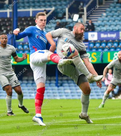 Stock Photo of Ronan Curtis of Portsmouth on the left battles for the ball with Michael Bostwick of Burton during the Sky Bet League One match between Portsmouth and Burton Albion at Fratton Park  , Portsmouth ,  UK - 10 April 2021