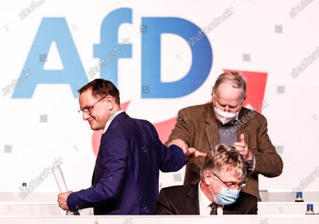 Alternative for Germany party (AfD) co-chairman Tino Chrupalla (L), Alternative for Germany party (AfD) co-chairman Joerg Meuthen (R) and Alternative for Germany (AfD) faction co-leader Alexander Gauland (back) react during Germany's right-wing populist Alternative for Germany (AfD) party convention in Dresden, Germany, 10 April 2021. AfD party convention takes place from 10 to 11 April 2021.