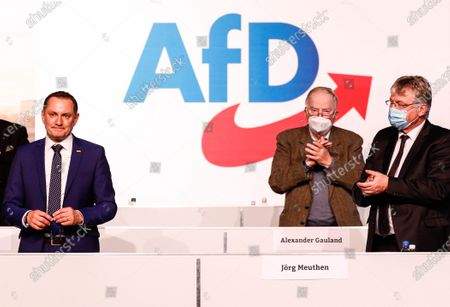 Alternative for Germany party (AfD) co-chairman Tino Chrupalla (L), Alternative for Germany party (AfD) co-chairman Joerg Meuthen (R) and Alternative for Germany (AfD) faction co-leader Alexander Gauland (C) react during Germany's right-wing populist Alternative for Germany (AfD) party convention in Dresden, Germany, 10 April 2021. AfD party convention takes place from 10 to 11 April 2021.