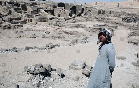 An Egyptian worker stands near an archeological discovery named the 'Lost Golden City' in Luxor, Egypt,  10 April 2021. Egyptian archaeologists have discovered a 3,000 years old city in Luxor. A mission under Dr. Zahi Hawass found the remains in excavation works that started in September 2020. The scientists believe the find dates back to the reign of Amenhotep III, and is thought to be used afterwards by Tutankhamun and Ay.