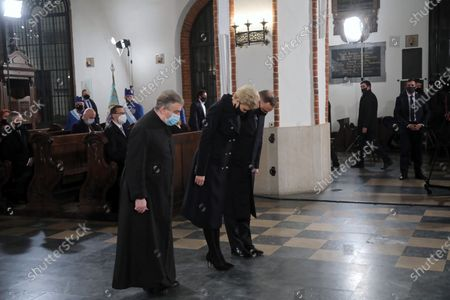 Polish President Andrzej Duda (R) and his wife Agata Kornhauser-Duda (C) attend a holy mass in the St. John's Archcathedral during the ceremonies commemorating the 11th anniversary of the presidential plane crash near Smolensk, in Warsaw, Poland, 10 April 2021. Poland's President Kaczynski, his wife and 94 others died on 10 April 2010 when Polish plane crashed in Smolensk, Russia.