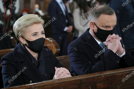 Polish President Andrzej Duda (R) and his wife Agata Kornhauser-Duda (L) attend a holy mass in the St. John's Archcathedral during the ceremonies commemorating the 11th anniversary of the presidential plane crash near Smolensk, in Warsaw, Poland, 10 April 2021. Poland's President Kaczynski, his wife and 94 others died on 10 April 2010 when Polish plane crashed in Smolensk, Russia.