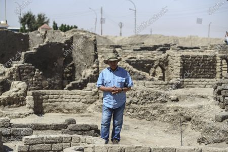 Stock Image of Dr. Zahi Hawass talks to media in a 3,000-year-old lost city in Luxor province, Egypt, . The newly unearthed city is located between the temple of King Rameses III and the colossi of Amenhotep III on the west bank of the Nile in Luxor. The city continued to be used by Amenhotep III's grandson Tutankhamun, and then his successor King Ay
