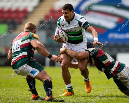 Stock Photo of Joel Matavesi of Newcastle Falcons is tackled by George Martin of Leicester Tigers
