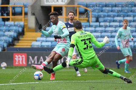 Jamal Lowe of Swansea City denied by Bartosz Bialkowski of Millwall