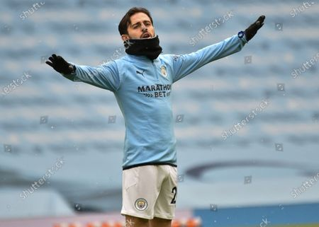Manchester City's Bernardo Silva gestures during a warm up ahead of the English Premier League soccer match between Manchester City and Leeds United at Etihad Stadium, Manchester, England