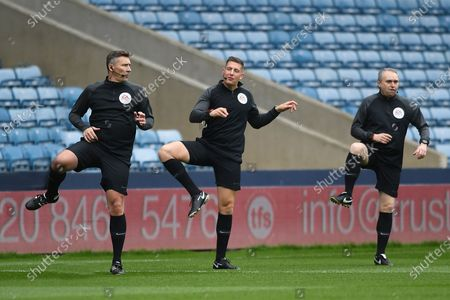 The Officials Assistant Referee Darren Cann Referee Robert Jonesand Assistant Referee Simon Beck during the EFL Sky Bet Championship match between Millwall and Swansea City at The Den, London