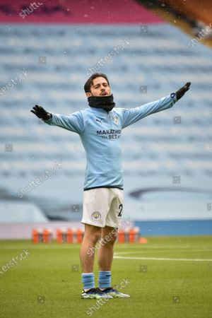 Bernardo Silva of Manchester City warms up ahead of the English Premier League soccer match between Manchester City and Leeds United in Manchester, Britain, 10 April 2021.