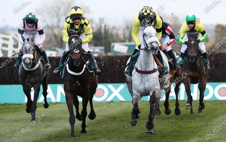 Jockey Nico De Boinville on Shishkin (L) and Tom O'Brien on Gumball (R) compete in the Doom Bar Maghull Novices' Chase race on Grand National Day at the Grand National Festival at the racecourse in Aintree, Britain, 10 April 2021. Shishkin won the race, Gumball placed third.