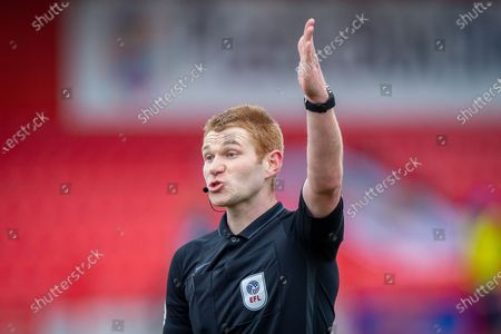 Stock Image of Referee James Oldham pointing, signalling, gesturing during the EFL Sky Bet League 1 match between Accrington Stanley and AFC Wimbledon at the Fraser Eagle Stadium, Accrington