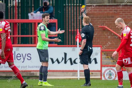 Stock Picture of Referee James Oldham shows AFC Wimbledon defender Ben Heneghan (22) his second yellow card, RED CARD, during the EFL Sky Bet League 1 match between Accrington Stanley and AFC Wimbledon at the Fraser Eagle Stadium, Accrington