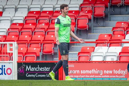 Stock Photo of Referee James Oldham (not in picture) gave AFC Wimbledon defender Ben Heneghan (22) his second yellow card, RED CARD, during the EFL Sky Bet League 1 match between Accrington Stanley and AFC Wimbledon at the Fraser Eagle Stadium, Accrington