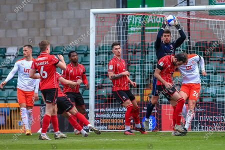 Alex Palmer (1) of Lincoln City  catches the ball midair  during the EFL Sky Bet League 1 match between Lincoln City and Blackpool at Sincil Bank, Lincoln