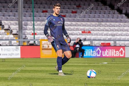 Alex Palmer (1) of Lincoln City  kicks the ball during the EFL Sky Bet League 1 match between Lincoln City and Blackpool at Sincil Bank, Lincoln