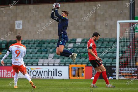 Alex Palmer (1) of Lincoln City  catches the ball during the EFL Sky Bet League 1 match between Lincoln City and Blackpool at Sincil Bank, Lincoln