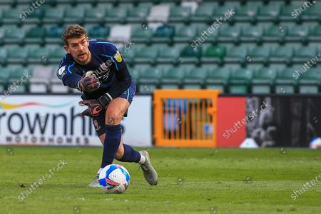 Alex Palmer (1) of Lincoln City  rolls out the ball during the EFL Sky Bet League 1 match between Lincoln City and Blackpool at Sincil Bank, Lincoln