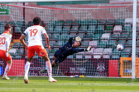 Alex Palmer (1) of Lincoln City saves a shot during the EFL Sky Bet League 1 match between Lincoln City and Blackpool at Sincil Bank, Lincoln