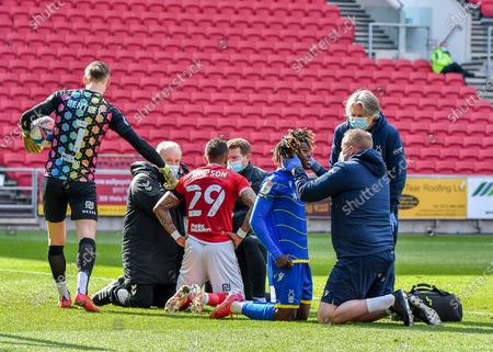 Nottingham Forest Midfielder Alex Mighten (17) and Bristol City defender Danny Simpson (29) received medical treatment after clashes of heads  during the EFL Sky Bet Championship match between Bristol City and Nottingham Forest at Ashton Gate, Bristol
