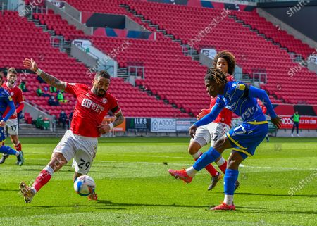 Nottingham Forest Midfielder Alex Mighten (17) takes a shoot and it is blocked by Bristol City defender Danny Simpson (29)  during the EFL Sky Bet Championship match between Bristol City and Nottingham Forest at Ashton Gate, Bristol