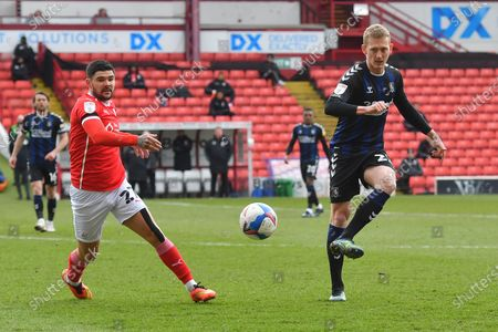 Stock Picture of Barnsley FC player Alex Mowatt (27) and Middlesbrough midfielder George Saville (22) during the EFL Sky Bet Championship match between Barnsley and Middlesbrough at Oakwell, Barnsley