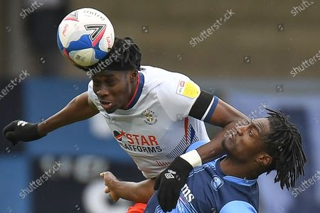 Stock Photo of Luton Town forward Elijah Adebayo (29) heads the ball under pressure from Wycombe Wanderers defender Anthony Stewart (5) during the EFL Sky Bet Championship match between Wycombe Wanderers and Luton Town at Adams Park, High Wycombe