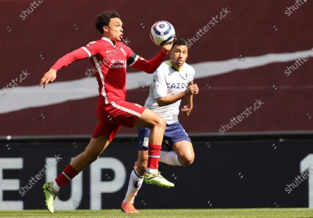 Liverpool's Trent Alexander-Arnold, left, and Aston Villa's Trezeguet challenge for the ball during the English Premier League soccer match between Liverpool and Aston Villa at Anfield stadium in Liverpool, England