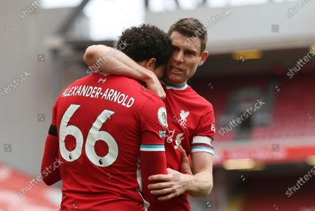 Liverpool's Trent Alexander-Arnold, left, celebrates with teammate Liverpool's James Milner after scoring his side's second goal during the English Premier League soccer match between Liverpool and Aston Villa at Anfield stadium in Liverpool, England