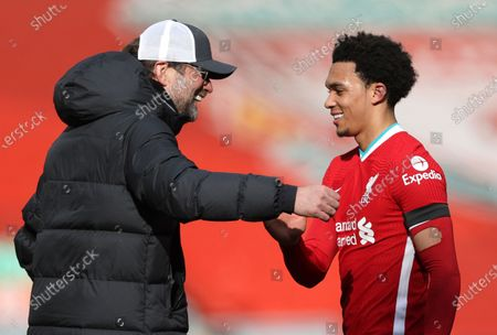Liverpool's manager Jurgen Klopp greets Trent Alexander-Arnold at the end of the English Premier League soccer match between Liverpool and Aston Villa at Anfield stadium in Liverpool, England