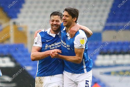 Stock Photo of Birmingham City forward Lukas Jutkiewicz (10) and Birmingham City defender George Friend (5) celebrate after the final whistle during the EFL Sky Bet Championship match between Birmingham City and Stoke City at the Trillion Trophy Stadium, Birmingham