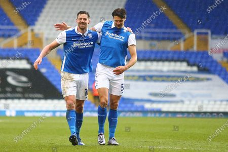 Birmingham City forward Lukas Jutkiewicz (10) and Birmingham City defender George Friend (5) celebrate after the final whistle  during the EFL Sky Bet Championship match between Birmingham City and Stoke City at the Trillion Trophy Stadium, Birmingham
