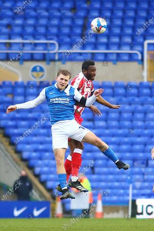 Birmingham City midfielder Riley McGree (18) and Stoke City midfielder Mikel John Obi (13) during the EFL Sky Bet Championship match between Birmingham City and Stoke City at the Trillion Trophy Stadium, Birmingham