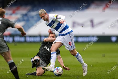 Lyndon Dykes (9) of Queens Park Rangers tussles with Sam Hutchinson (6) of Sheffield Wednesday during the EFL Sky Bet Championship match between Queens Park Rangers and Sheffield Wednesday at the Kiyan Prince Foundation Stadium, London