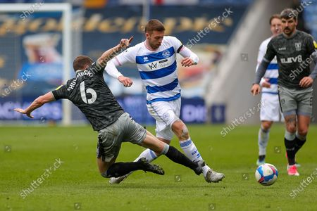 Sam Field (15) of Queens Park Rangers is challenged by Sam Hutchinson (6) of Sheffield Wednesday during the EFL Sky Bet Championship match between Queens Park Rangers and Sheffield Wednesday at the Kiyan Prince Foundation Stadium, London