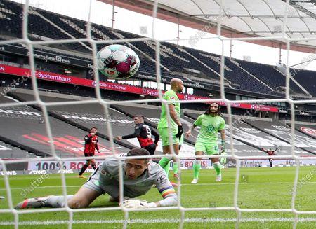 Frankfurt's Luka Jovic (C-back) scores the 2-1 lead against Wolfsburg's goalkeeper Koen Casteels (front) during the German Bundesliga soccer match betweenEintracht Frankfurt and Wolfsburg in Frankfurt, Germany, 10 April 2021.