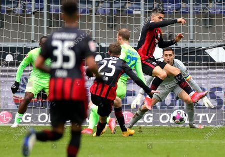 Stock Image of Frankfurt's Erik Durm (C) scores the 4-2 lead against Wolfsburg's goalkeeper Koen Casteels (R) during the German Bundesliga soccer match between Eintracht Frankfurt and Wolfsburg in Frankfurt, Germany, 10 April 2021.