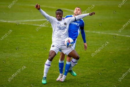 Stock Photo of Shrewsbury Town forward Daniel Udoh (23) and Gillingham FC midfielder Stuart O'Keefe (4) during the EFL Sky Bet League 1 match between Gillingham and Shrewsbury Town at the MEMS Priestfield Stadium, Gillingham